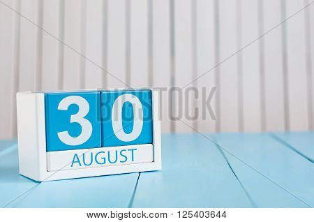 August 30th. Image of august 30 wooden color calendar on blue background. Summer day. Empty space for text.