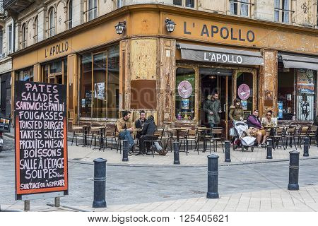 Bordeaux France - March 25 2016. People in the bar terrace of Apollo cafe in Place Fernand Laffargue square Bordeaux. Aquitaine. France.