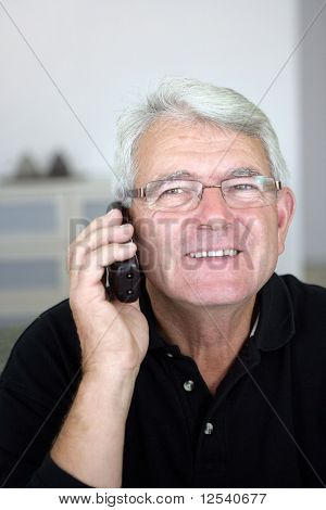 Portrait of a smiling senior man phoning