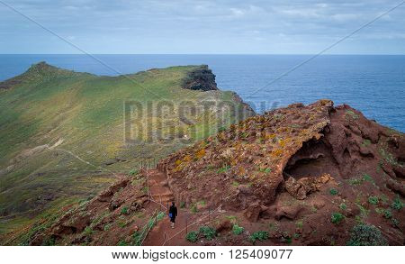 Woman hiking at the hills of Madeira volcanic landscape. East coast of Madeira island, Portugal.