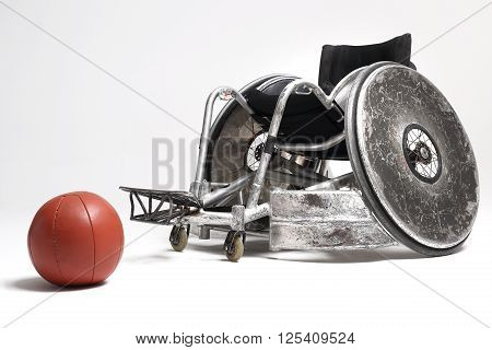 Wheelchair and medicine ball , Sport for the disabled .