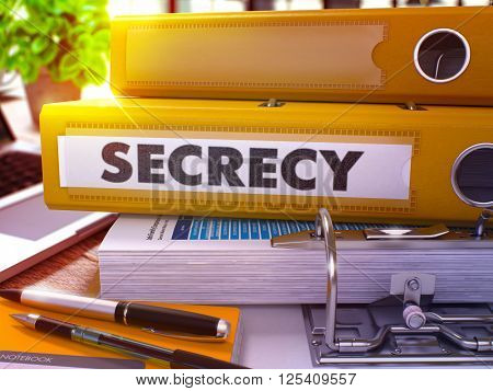 Yellow Ring Binder with Inscription Secrecy on Background of Working Table with Office Supplies and Laptop. Secrecy - Toned Illustration. Secrecy Business Concept on Blurred Background. 3D Render.