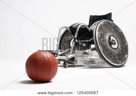 Sport for the disabled, Wheelchair and medicine ball .