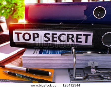 Top Secret - Black Ring Binder on Office Desktop with Office Supplies and Modern Laptop. Top Secret Business Concept on Blurred Background. Top Secret - Toned Illustration. 3D Render.