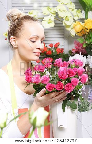 Beautiful cut flowers, florist arranges medley .