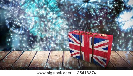 Great Britain flag suitcase against colourful fireworks exploding on black background