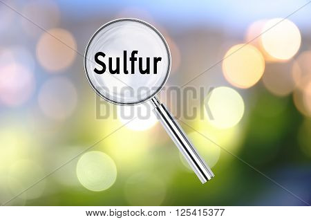 Magnifying lens over background with text Sulfur, with the blurred lights visible in the background. 3D rendering.