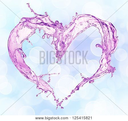 Heart from water splash with bubbles. Bokeh background
