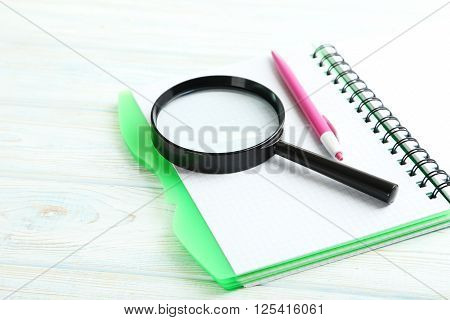 Magnifying Glass On A Blue Wooden Table