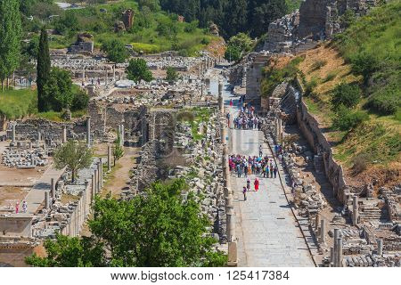 SELCUK, TURKEY - MAY 3, 2015: tourists watching the ruins of ancient Ephesus