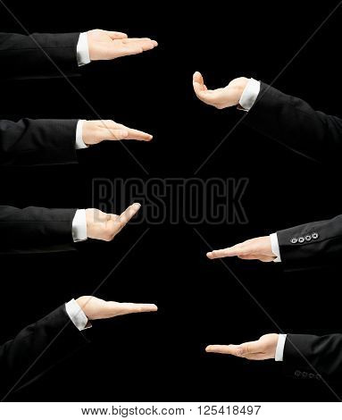 Caucasian male hand in a business suit, opened palm gesture sign in seven versions, low-key lighting composition, isolated over the black background