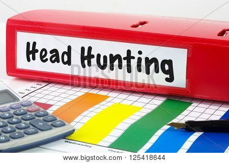 head hunting against business desk with documents