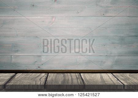 Wooden desk against bleached wooden planks background
