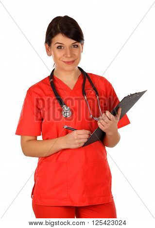 Happy young nurse standing on isolated background with a clipboard in her hand