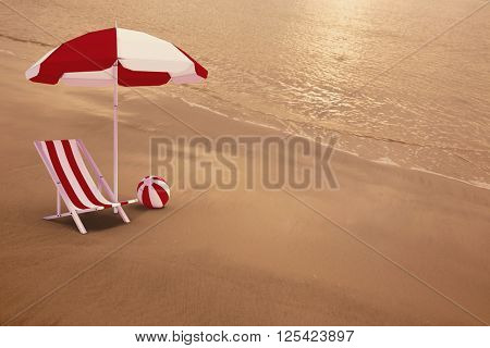 Image of sun lounger and sunshade against the tide rolling in