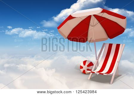 Image of sun lounger and sunshade against bright blue sky with clouds