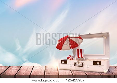 Image of a suitcase against blue sky