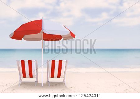 Image of sun lounger and sunshade against waters edge at the beach