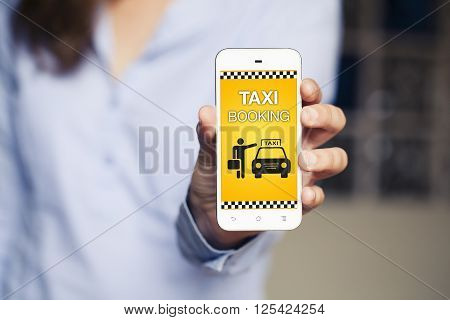 Taxi booking app on a mobile phone held by woman hand.