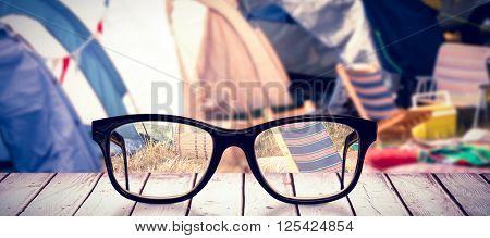 Black glasses against campsite
