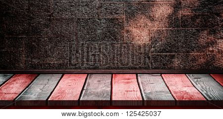 Red and khaki parquet against image of a wall