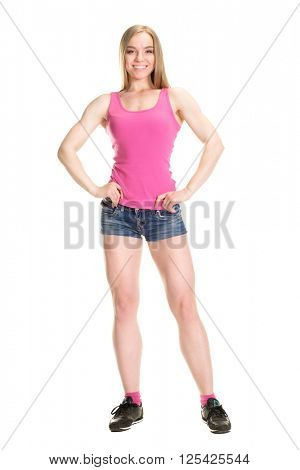 Young muscular woman posing on white background isolated