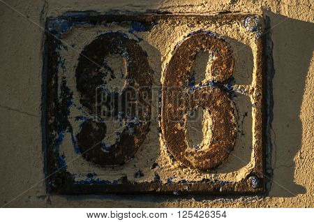 Old retro weathered cast iron plate with number 96
