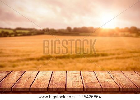Wooden table against landscape of countryside