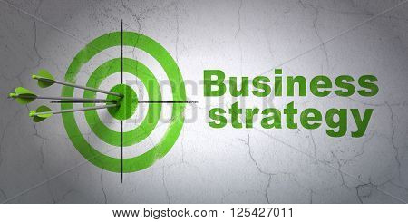 Business concept: target and Business Strategy on wall background