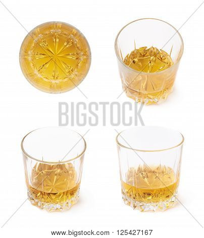 Glass tumbler filled with whiskey bourbon isolated over the white background, set of four different foreshortenings