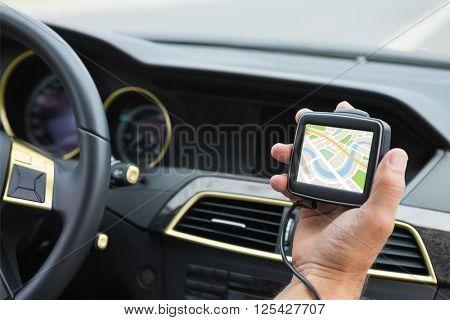 Digital image of map against man using satellite navigation system