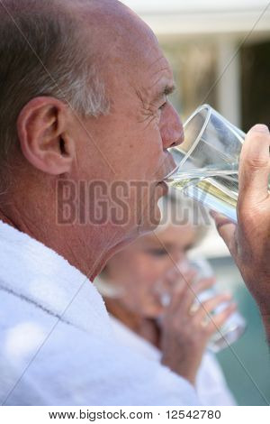 Portrait of a senior man drinking a glass of water