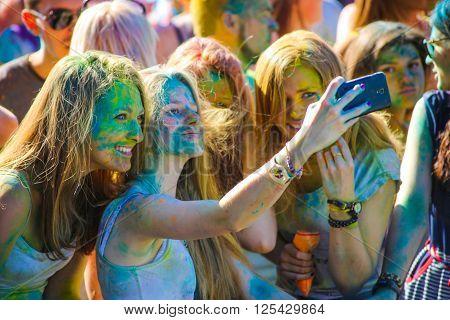 Vitebsk, Belarus - July 4, 2015: Happy girls take a selfie at the Holi color festival