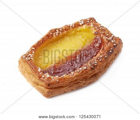 Sweet bread bun pastry filled and covered with the red and yellow cream filling, isolated over the white background
