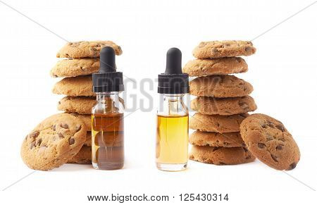 Oil essence in a glass bottle next to the pile of cookies isolated over the white background, set of two different foreshortenings