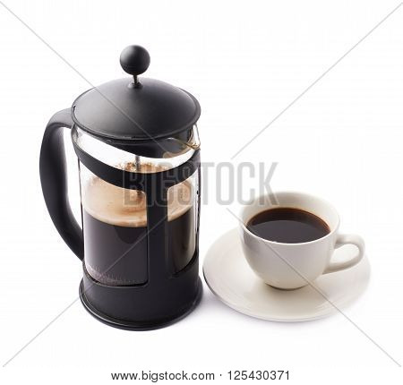 French press coffee pot next to cup of coffee, composition isolated over the white background