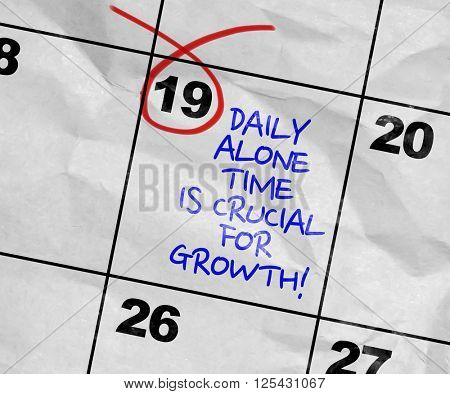 Concept image of a Calendar with the text: Daily Alone Time Is Crucial For Growth!