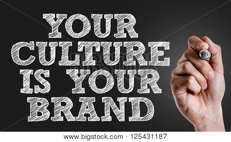 Hand writing the text: Your Culture is Your Brand