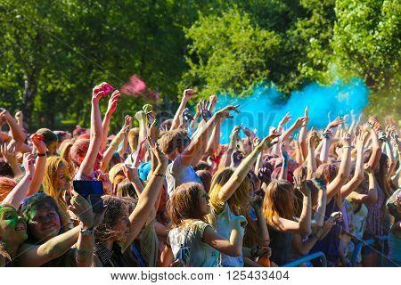 Vitebsk, Belarus - July 4, 2015: Throwing color at the Holi color festival