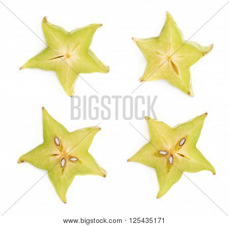 Averrhoa carambola starfruit cross-section slice isolated over the white background, set of four different images
