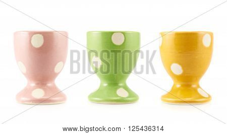Colorful empty egg holder isolated over the white background, set of three color versions