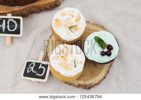 three of spongecake or muffin with cream
