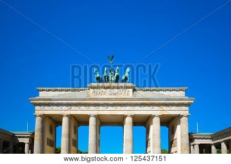 BERLIN, GERMANY- MAY 15, 2013: Brandenburg Gate (Brandenburger Tor) famous landmark in Berlin, Germany,rebuilt in the late 18th century as a neoclassical triumphal arch. May 15, 2013 in Berlin