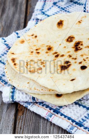 Homemade Naan Flatbread stack on table cloth