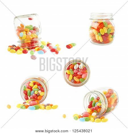 Composition of a glass jar and multiple colorful jelly bean candies, isolated over the white background, set of multiple foreshortenings