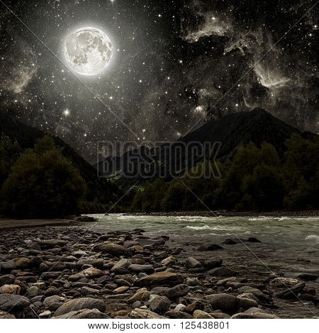mountain. backgrounds night sky with stars and moon and clouds.  Elements of this image furnished by NASA
