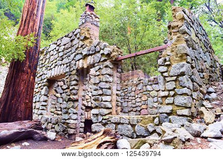 Forgotten home with its stone foundation which was burnt down from a fire taken in the rural forest