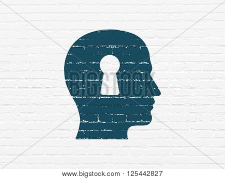 Finance concept: Head With Keyhole on wall background