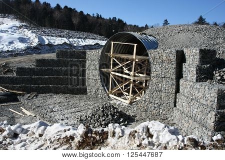 The construction of culverts under a road