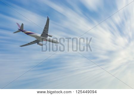 Airplane high speed on the clouds sky.